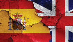 flags of Spain and UK painted on cracked wall